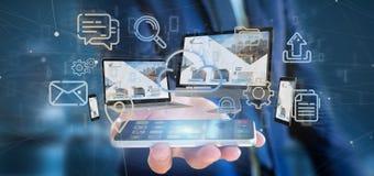 Homme d'affaires tenant des dispositifs reliés à un rendu du réseau 3d de multimédia de nuage images libres de droits