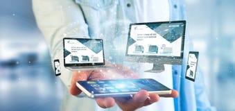 Homme d'affaires tenant des dispositifs reliés à un rendu du réseau 3d d'affaires globales photographie stock