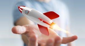 Homme d'affaires tenant et touchant un rendu de la fusée 3D Photos stock