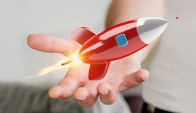 Homme d'affaires tenant et touchant un rendu de la fusée 3D Image libre de droits