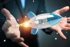 Homme d'affaires tenant et touchant un rendu de la fusée 3D Photo stock