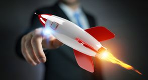 Homme d'affaires tenant et touchant un rendu de la fusée 3D Images stock