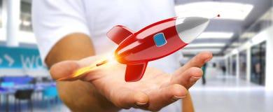 Homme d'affaires tenant et touchant un rendu de la fusée 3D Photographie stock libre de droits