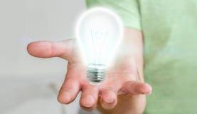 Homme d'affaires tenant l'ampoule brillante dans son rendu de la main '3D Image stock
