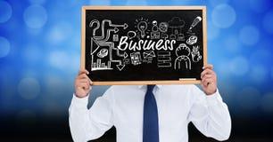 Homme d'affaires tenant l'ardoise avec le texte et les icônes d'affaires Photo libre de droits