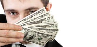 Homme d'affaires tenant l'argent photographie stock