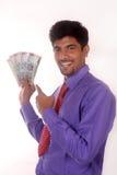 Homme d'affaires tenant l'argent indien Images libres de droits