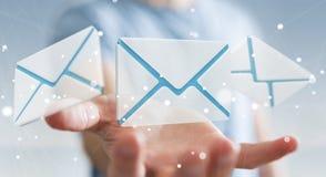 Homme d'affaires tenant l'icône d'email de vol du rendu 3D dans sa main Photographie stock