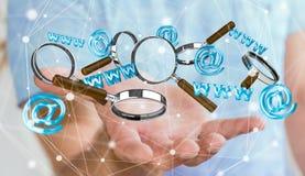 Homme d'affaires tenant l'icône de contact du rendu 3D et magnifiant le gla Photo libre de droits