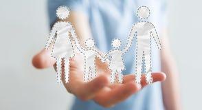 Homme d'affaires tenant l'interface de famille dans son rendu de la main 3D Photo libre de droits