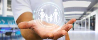 Homme d'affaires tenant l'interface de famille dans son rendu de la main 3D Images libres de droits