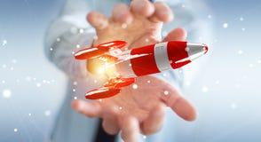 Homme d'affaires tenant la fusée rouge dans son rendu de la main 3D Images stock