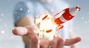 Homme d'affaires tenant la fusée rouge dans son rendu de la main 3D Photo stock