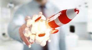 Homme d'affaires tenant la fusée rouge dans son rendu de la main 3D Image stock