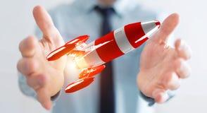Homme d'affaires tenant la fusée rouge dans son rendu de la main 3D Photographie stock libre de droits