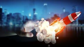 Homme d'affaires tenant la fusée rouge dans son rendu de la main 3D Images libres de droits