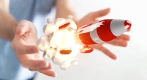 Homme d'affaires tenant la fusée rouge dans son rendu de la main 3D Photos libres de droits