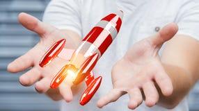 Homme d'affaires tenant la fusée rouge dans son rendu de la main 3D Image libre de droits