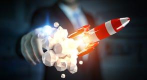 Homme d'affaires tenant la fusée rouge dans son rendu de la main 3D Photographie stock