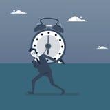 Homme d'affaires tenant le concept de date-butoir de gestion du temps d'horloge Photos stock