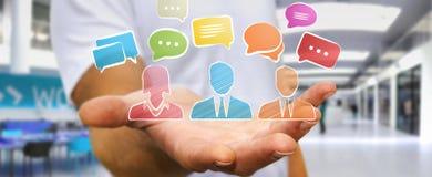 Homme d'affaires tenant le croquis d'icônes de discussion Image stock