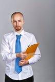 Homme d'affaires tenant le dossier Photographie stock