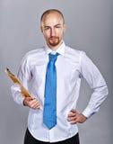 Homme d'affaires tenant le dossier Image stock