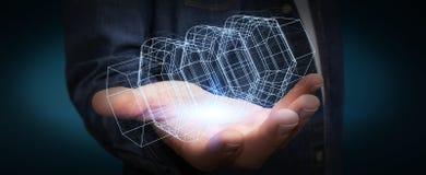Homme d'affaires tenant le moteur 3D numérique Image libre de droits