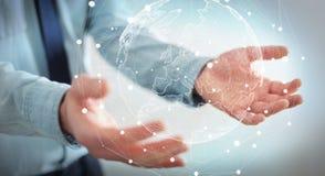 Homme d'affaires tenant le réseau global sur le rendu de la terre 3D de planète Images stock
