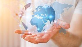 Homme d'affaires tenant le réseau global sur le rendu de la terre 3D de planète Photo stock