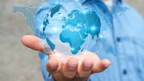 Homme d'affaires tenant le réseau global sur le rendu de la terre 3D de planète Photographie stock