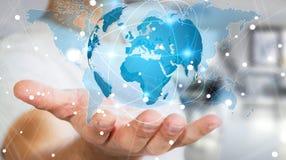 Homme d'affaires tenant le réseau global sur le rendu de la terre 3D de planète Image libre de droits