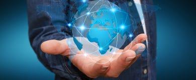 Homme d'affaires tenant le réseau global sur le rendu de la terre 3D de planète Photo libre de droits