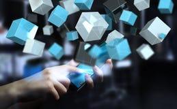 Homme d'affaires tenant le renderin brillant bleu de flottement du réseau 3D de cube Images libres de droits