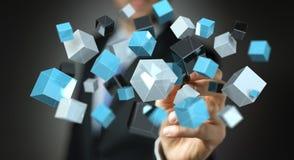 Homme d'affaires tenant le renderin brillant bleu de flottement du réseau 3D de cube Image stock