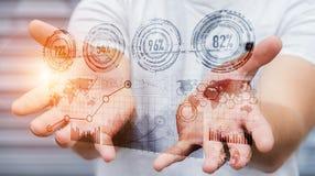 Homme d'affaires tenant le rendering' numérique de l'interface '3D de graphique Photographie stock