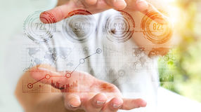 Homme d'affaires tenant le rendering' numérique de l'interface '3D de graphique Images libres de droits