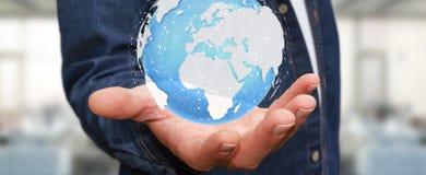 Homme d'affaires tenant le rendering' tactile numérique du monde '3D Photographie stock libre de droits