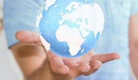Homme d'affaires tenant le rendering' tactile numérique du monde '3D Images stock