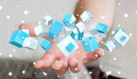 Homme d'affaires tenant le rendu brillant bleu volant du cube 3D Photos libres de droits