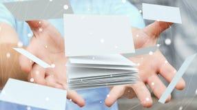 Homme d'affaires tenant le rendu de flottement de la carte de visite professionnelle de visite 3D Photographie stock libre de droits