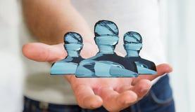 Homme d'affaires tenant le rendu en verre brillant du groupe 3D d'avatar Images libres de droits