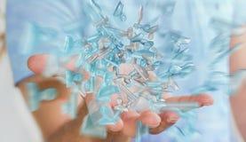 Homme d'affaires tenant le rendu en verre brillant du groupe 3D d'avatar Image stock