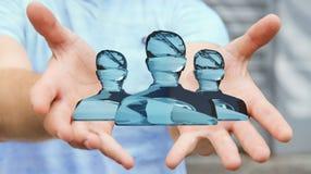 Homme d'affaires tenant le rendu en verre brillant du groupe 3D d'avatar Photographie stock