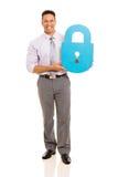 Homme d'affaires tenant le symbole de serrure Image libre de droits