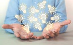 Homme d'affaires tenant les ampoules Concept de nouvelle idée image libre de droits