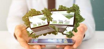 Homme d'affaires tenant les dispositifs reliés entourant par le rendu des feuilles 3d photos stock