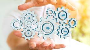 Homme d'affaires tenant les icônes colorées de vitesse dans son rendu de la main 3D Images stock