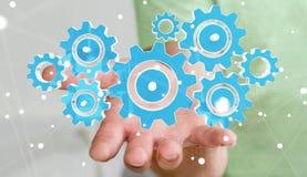 Homme d'affaires tenant les icônes colorées de vitesse dans son rendu de la main 3D Images libres de droits