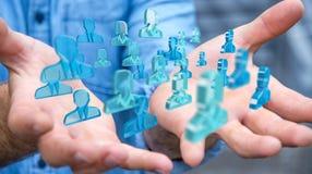 Homme d'affaires tenant 3D rendant le groupe de personnes bleues Image libre de droits